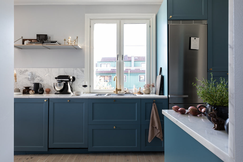 Swedish style kitchen with lovely blue cabinets