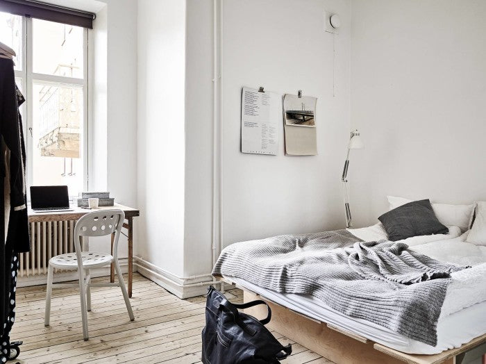 Bedroom of Swedish apartment with bespoke plywood furniture througout