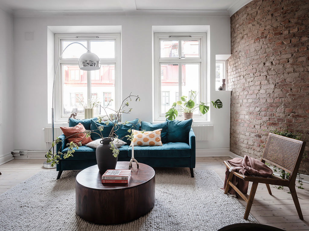 Blue sofa perfectly suites this Swedish home