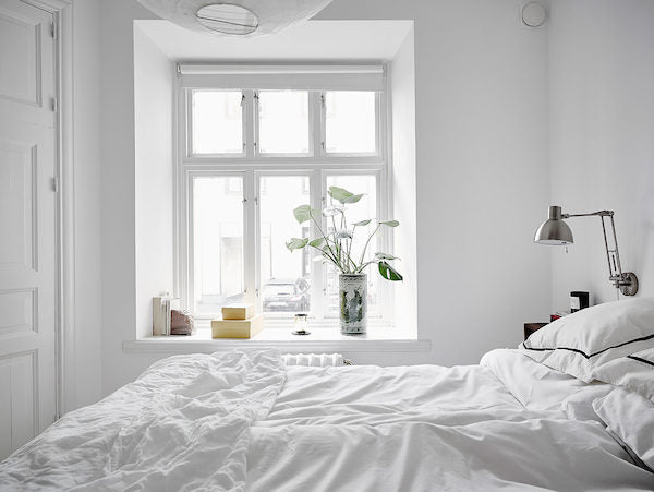 Bedroom of bright and open Swedish apartment