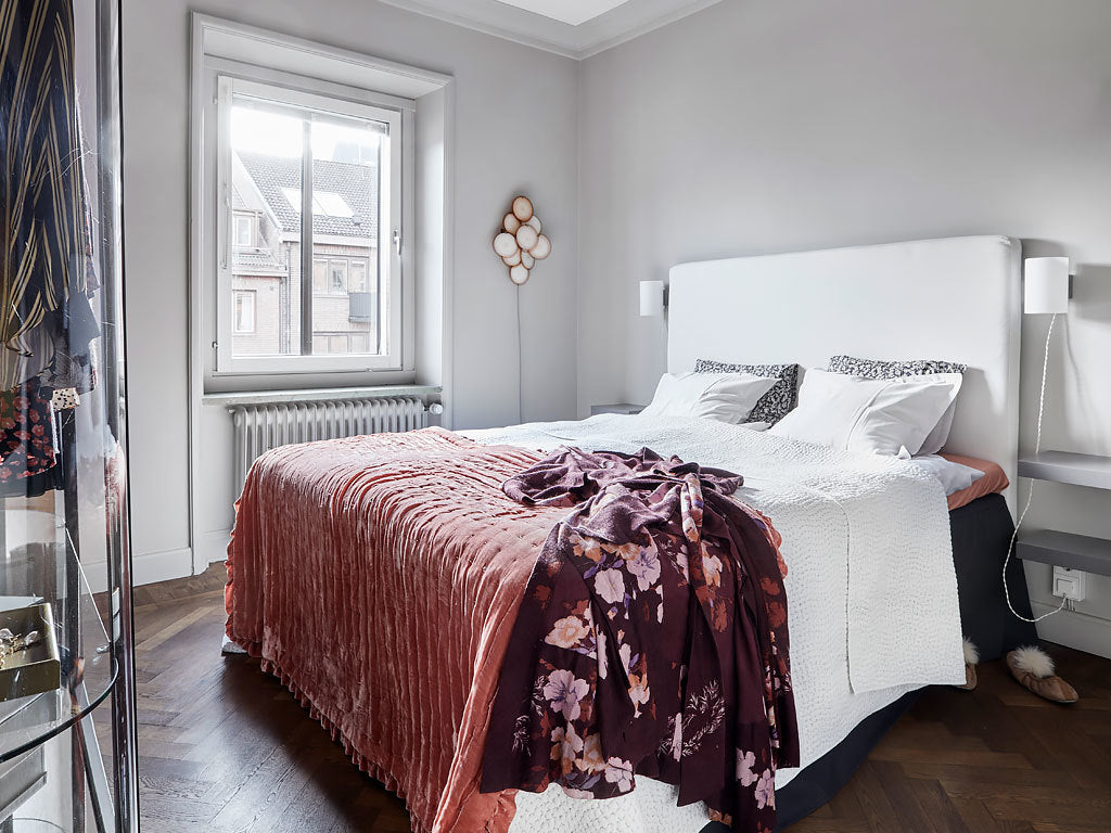 bedroom in Swedish apartment with traditional and modern style