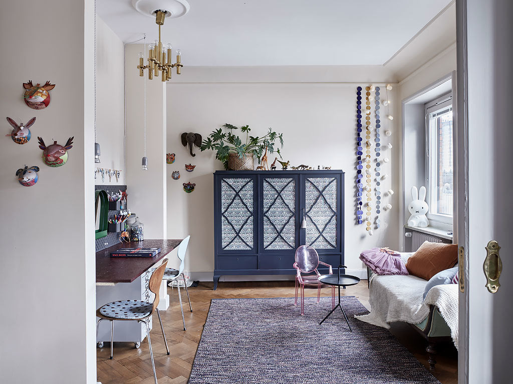Children's room in Swedish apartment with traditional and modern mix