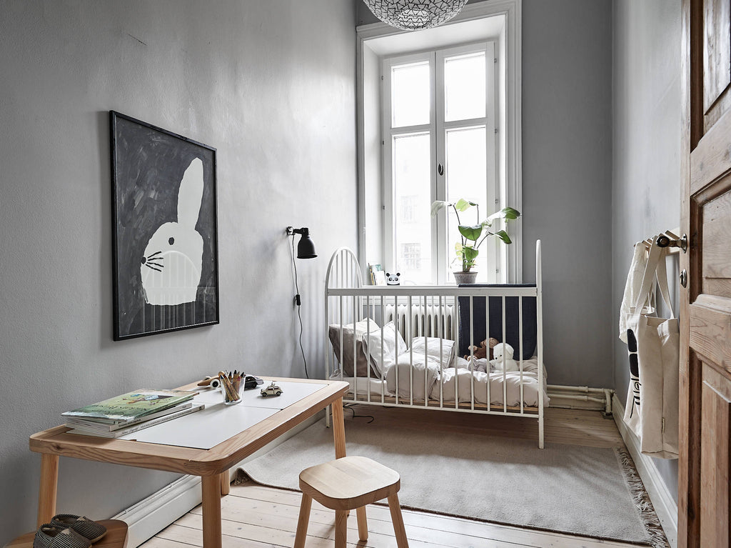 Warm neutral-toned baby's room in Gothenburg apt. Kungshöjdsgatan