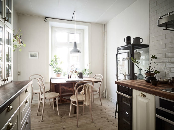 Scandinavian kitchen style in laid back Swedish apt.