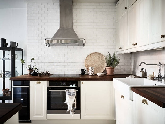 Swedish kitchen with subway tile back splash