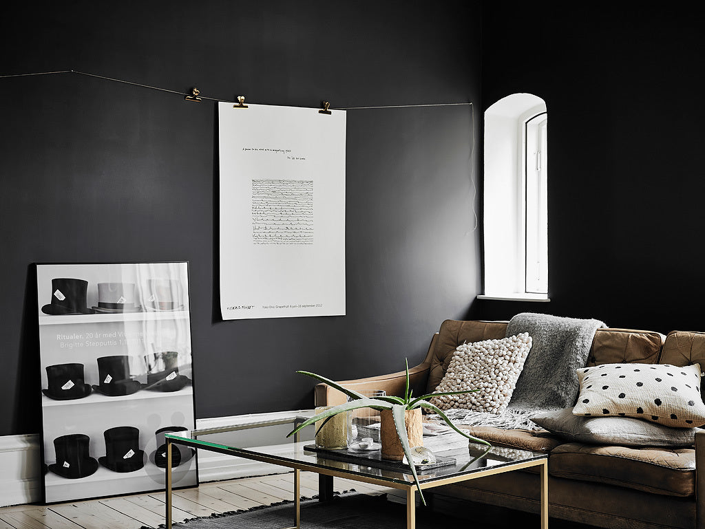 Cosy corner of Gothenburg apartment with beautiful dark walls