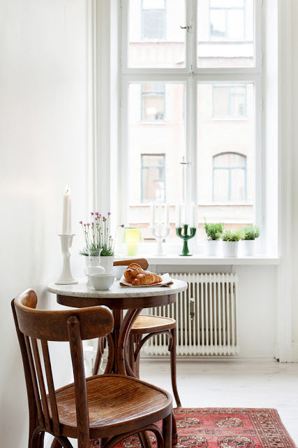 Detail of small table and chairs in Scandinavian kitchen