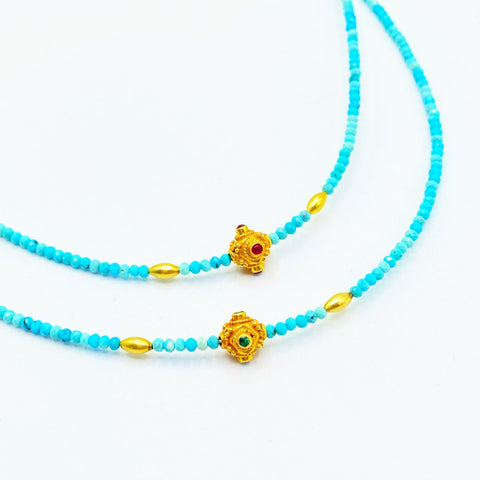 TURQUOISE NECKLACE WITH GOLD EMERALD OR RUBY BEAD