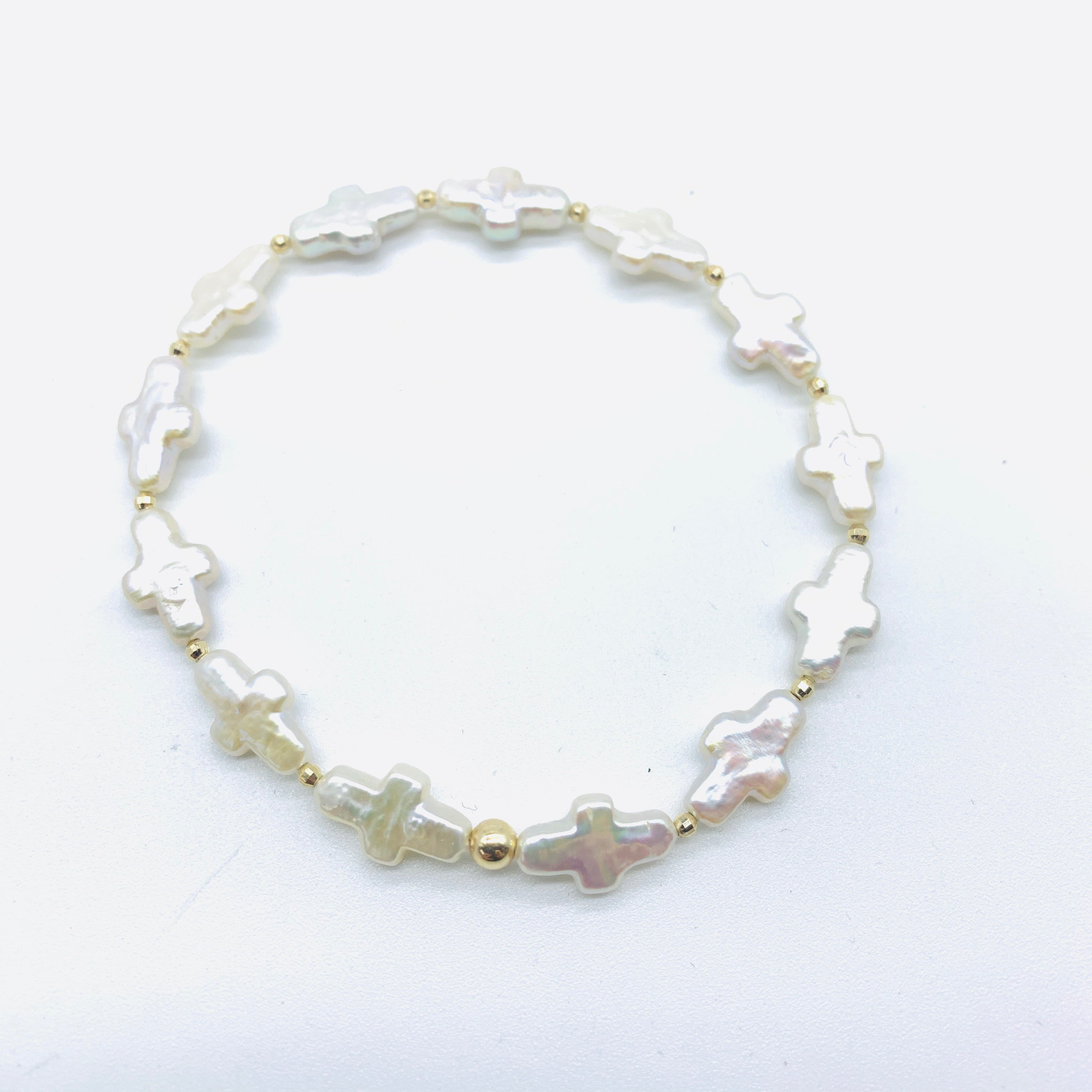 MOTHER OF PEARL CROSS BRACELET WITH 14K GOLD