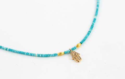 TURQUOISE WITH GOLD AND DIAMOND HAMSA.