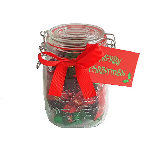 Christmas themed lolly jar filled to the brim with mixed Christmas coloured fudge
