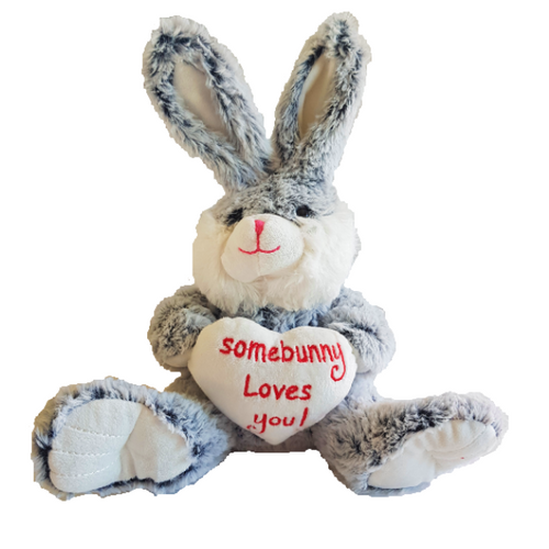 Large cuddly soft plush toy - grey bunny with large ears and feet sitting up holding a large white loveheard that says