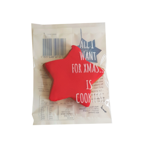 Christmas star gingerbread cookie with red icing