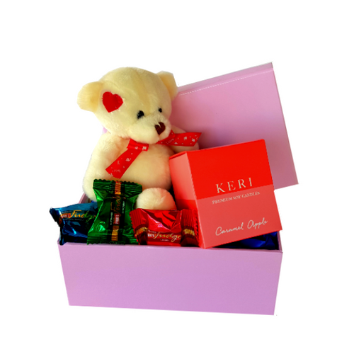 Teddy bear with soy candle in bright red box with three pieces of individually wrapped coloured fudge peices. All in a pink presentation box