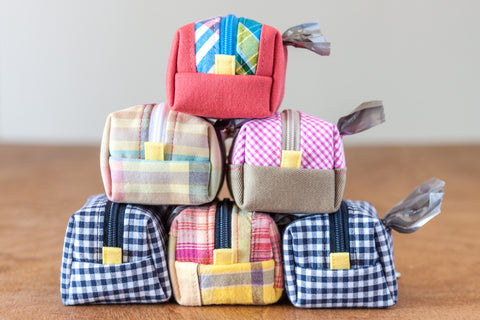 Gingham and plaid poo bag dispensers handcrafted from reclaimed materials by Oxford Dogma