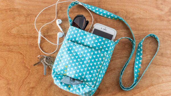 Sew a dog walking bag that dispense a roll of poo bags and holds a few necessities like phone and keys