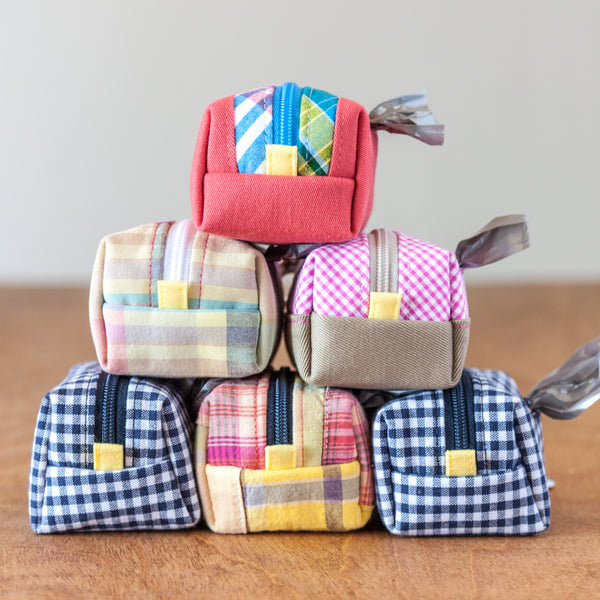 Poop Bag Dispensers from Oxford Dogma are available in a variety of colors and patterns including gingham and plaid