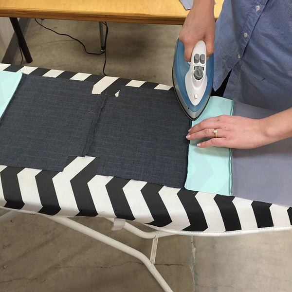 pressing seams on the pieced drawstring bag