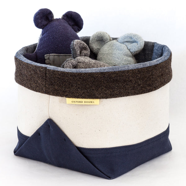 Canvas organizing bin keeps pet toys gathered at pet-height | oxforddogma.com