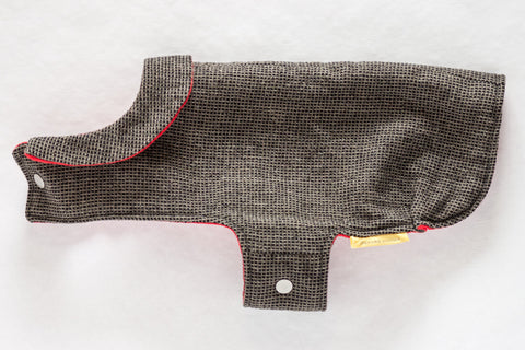 Refined and timeless jacket with a cute collar for a small dog made from black and tan reclaimed wool with a soft and cozy red flannel lining | oxforddogma.com
