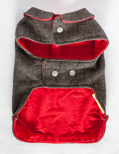 This dog jacket features a cute collar and snap closures and is made from black and tan reclaimed wool with a soft and cozy red flannel lining | oxforddogma.com