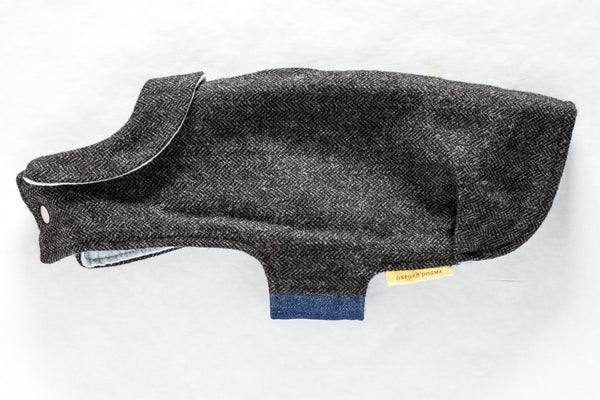 Refined and timeless jacket with a cute collar for a small dog made from navy herringbone reclaimed wool with a soft and cozy grey flannel lining | oxforddogma.com