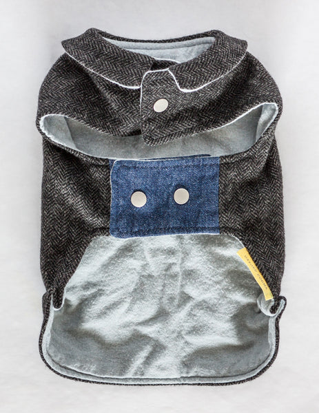 This dog jacket features a cute collar and snap closures and is made from navy herringbone reclaimed wool with a soft and cozy grey flannel lining | oxforddogma.com