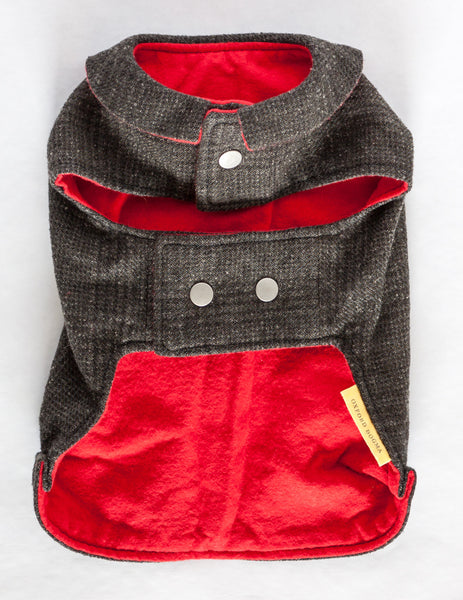 This dog jacket features a cute collar and snap closures and is made from navy plaid reclaimed wool with a soft and cozy red flannel lining | oxforddogma.com