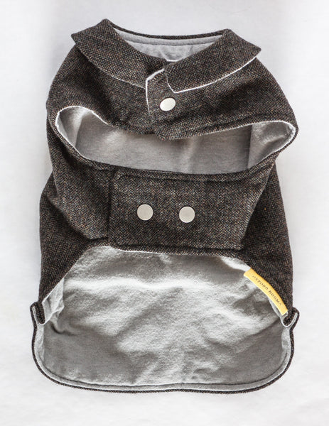 This dog jacket features a cute collar and snap closures and is made from navy and olive tweed reclaimed wool with a soft and cozy grey flannel lining | oxforddogma.com