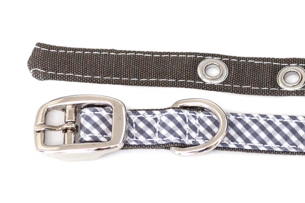 This classic dog collar is handcrafted from reclaimed materials in grey and white gingham and olive-grey cotton | oxforddogma.com