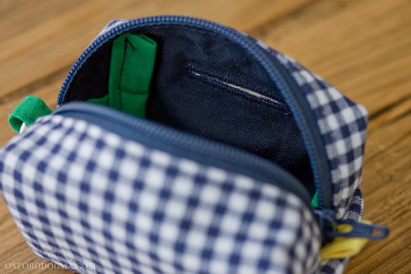 Stylish and refined poo bag dispenser in gingham with navy blue lining | oxforddogma.com
