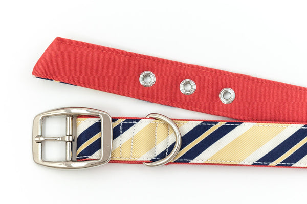 This classic dog collar is handcrafted from reclaimed materials in yellow, navy, and salmon pink | oxforddogma.com