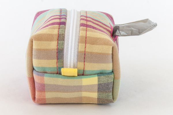Pull out a bag for cleaning up after your dog with this madras plaid clip-on bag dispenser | oxforddogma.com