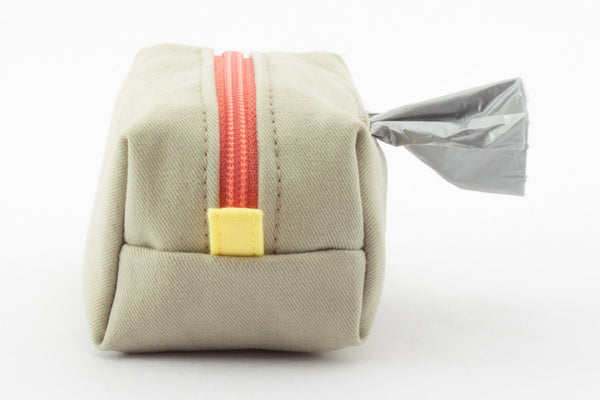 Pull out a bag for cleaning up after your dog with this tan clip-on bag dispenser | oxforddogma.com