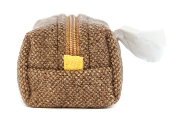 Pull out a bag for cleaning up after your dog with this handcrafted camel tweed clip-on bag dispenser | oxforddogma.com