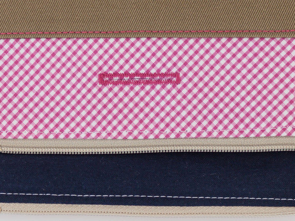 Stylish and refined poo bag dispenser in pink and white gingham with navy blue lining | oxforddogma.com