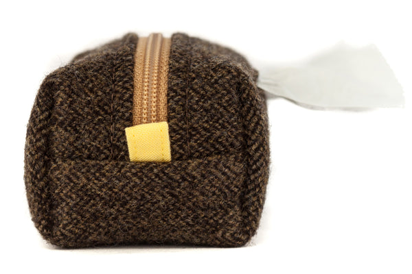 Pull out a bag for cleaning up after your dog with this handcrafted olive green herringbone wool clip-on bag dispenser | oxforddogma.com