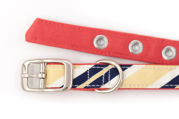 This classic dog collar is handcrafted from reclaimed materials in yellow, navy blue, and salmon pink | oxforddogma.com