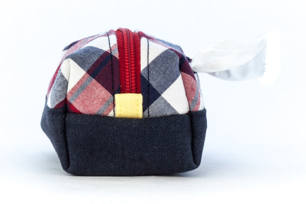 Pull out a bag for cleaning up after your dog with this handcrafted red, white, and blue clip-on bag dispenser | oxforddogma.com