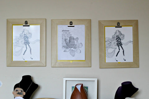 Ahimsa print downloaded and hung up on the wall using clipboards