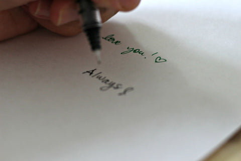 Writing a note on the inside of the card