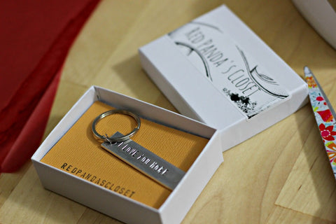 Red Panda's Closet packaging keychain in a box
