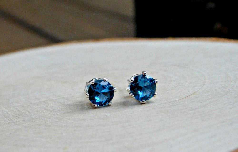 facet blue topaz birthstone bezel sterling round december stud silver earrings