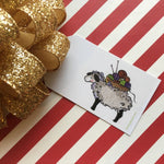 Holiday Gift Tag with sheep holding basket of yarn balls