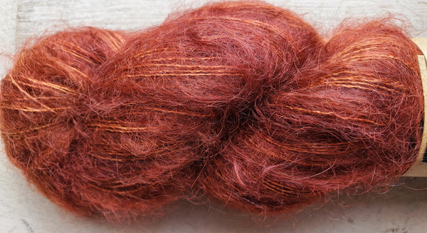Madelinetosh hand dyed mohair yarn in the color Saffron (rusty)