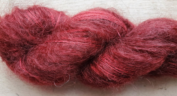 Madelinetosh hand dyed mohair yarn in the color Tart (red)