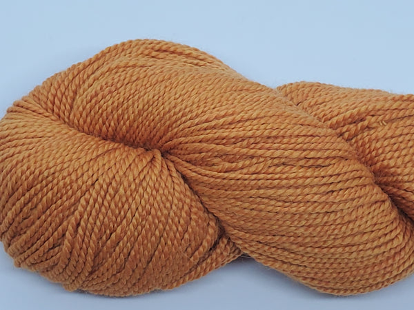 Mirasol Umina yarn in the color Clementine (light orange)