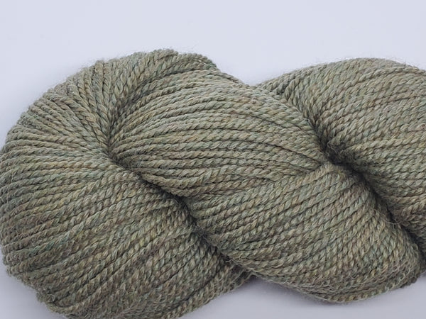 Mirasol Umina yarn in the color Jungle (olive green)