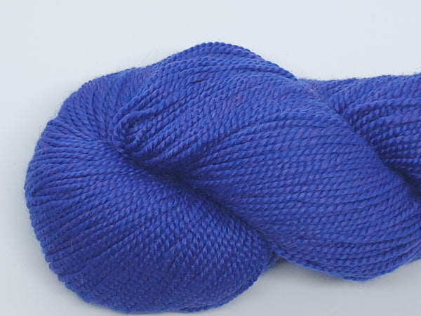 Mirasol Umina yarn in the color Royalty (bright purple)