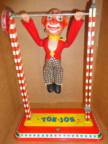 Battery Operated ACROBAT CLOWN 1960s mechanical tin litho & plastic CIRCUS performer
